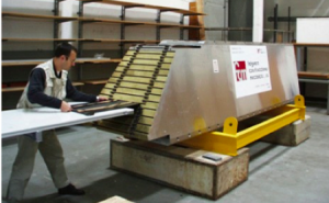 Megatile being inserted between brass absorbers in HB